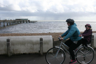 Bike with child seat by Deal Pier