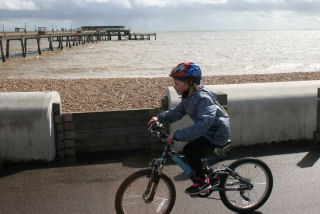 Child bike by Deal pier
