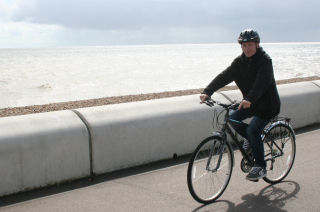 Adult bike along Deal beach